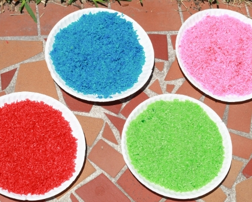 colored rice drying in the sun