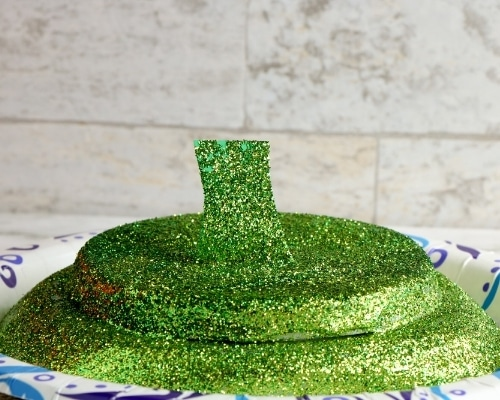 tide pod lid with green glitter