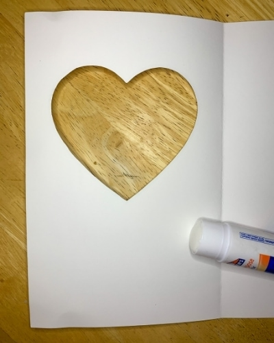 glue stick on white heart card