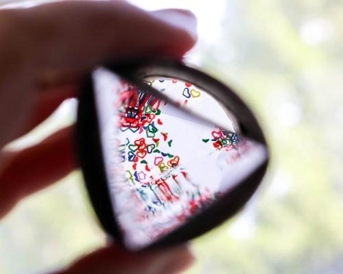 view through DIY kaleidoscope in front of window