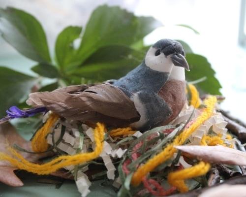 faux bird nest with bird